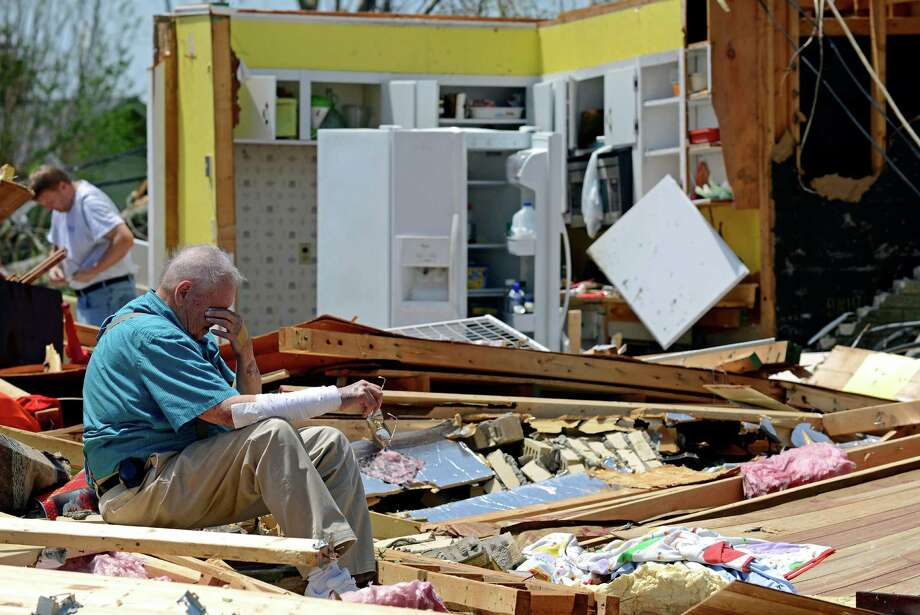 Charles Milam takes a break while searching his destroyed home in Tupelo, Miss. He, his wife and his granddaughter were at home when the tornado hit. Photo: Thomas Graning, FRE / FR171019 AP