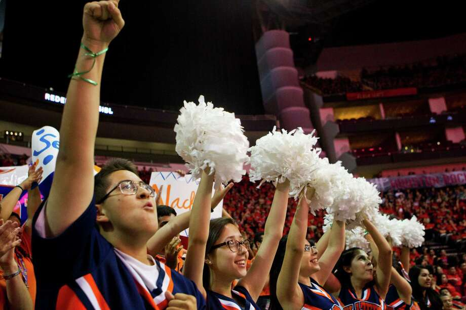 Victor Felipe, 17, a cheer leader at the Yes Prep North Central High School, celebrates the achievements by his fellow classmates in receiving acceptance letters from various colleges during the Yes Prep Seniors Signing Day, Tuesday, April 29, 2014, at the Toyota Center in Houston. Photo: Marie D. De Jesus, Houston Chronicle / © 2014 Houston Chronicle