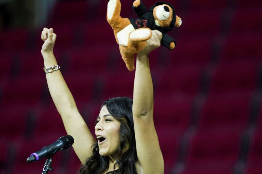 Yes Prep Southeast High School's student Melissa de Leon, 18, shouts her intention of going to Austin College this coming school year at the Yes Prep Signing Day 2014,  Tuesday, April 29, 2014, in Houston. Photo: Marie D. De Jesus, Houston Chronicle / © 2014 Houston Chronicle