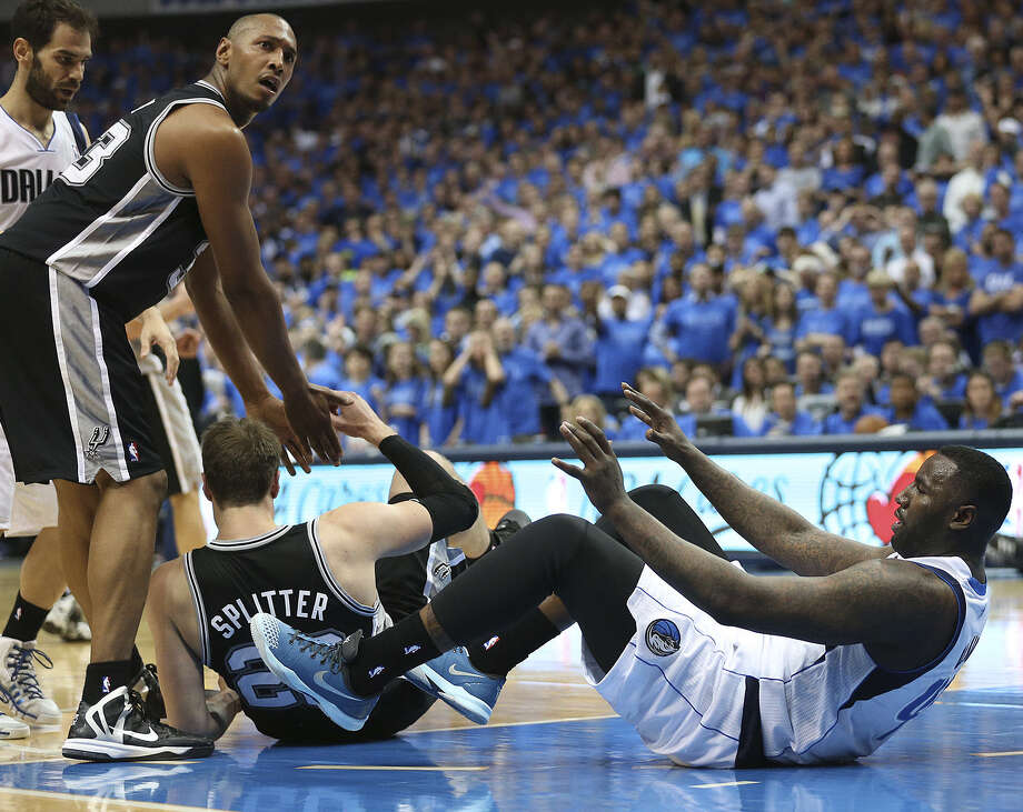 Former Spur DeJuan Blair (right), who was ejected after kicking Tiago Splitter on Monday in Dallas, was suspended despite claiming the act was an accident. Photo: Jerry Lara / San Antonio Express-News / ©2014 San Antonio Express-News