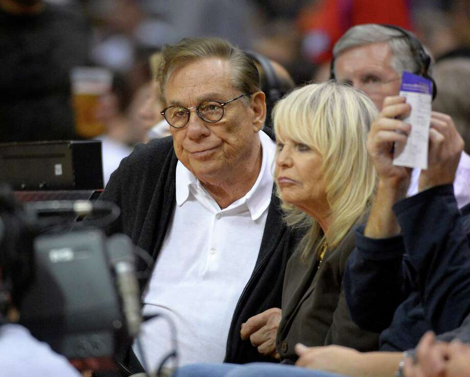 Donald Sterling, with his wife, Rochelle Stein, at a game in Los Angeles, can no longer have any connection with the Los Angeles Clippers. Photo: Mark J. Terrill, STF / AP