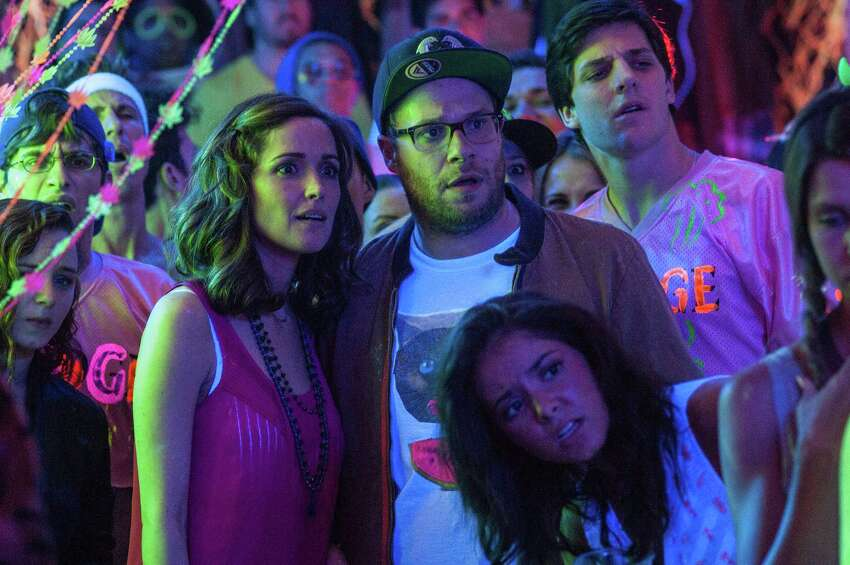 This image released by Universal Pictures shows Rose Byrne, left, and Seth Rogen in a scene from