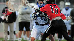 Boys lacrosse action between Fairfield Warde and Fairfield Ludlowe in Fairfield, Conn. on Tuesday April 29, 2014.