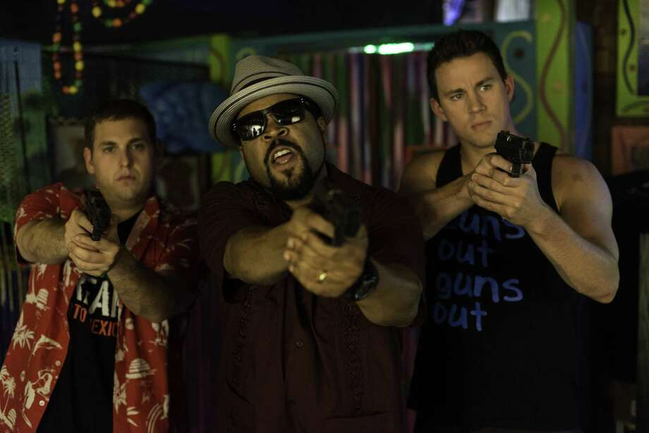"Schmidt (Jonah Hill, left) and Jenko (Channing Tatum, right) with Dickson (Ice Cube) confront the bad guys in ""22 Jump Street."" Photo: HANDOUT, McClatchy-Tribune News Service / MCT"