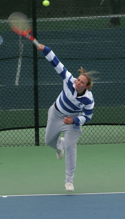 Fairfield Ludlowe junior Lindsey Evan returning a shot at first singles on Tuesday, April 29 in an FCIAC girls tennis match on the Falcons' courts. Ludlowe beat Warde 5-2. Evans won her match over Emily Simonds in straight sets 6-0, 6-0. Photo: Andy Hutchison / Fairfield Citizen