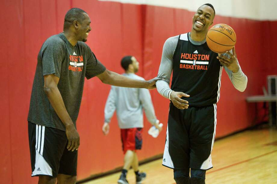 If Dwight Howard, right, is feeling the pressure of facing elimination tonight, it didn't show Tuesday at practice as he interacted with Hakeem Olajuwon, who knows a thing or two about overcoming playoff deficits. Photo: Brett Coomer, Staff / © 2014 Houston Chronicle