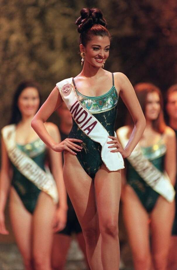Here, Aishwarya Rai of India competes in the swimsuit parade during the finals for Miss World 1994 in Sun City. Photo: WALTER DHALDHLA, AFP/Getty Images