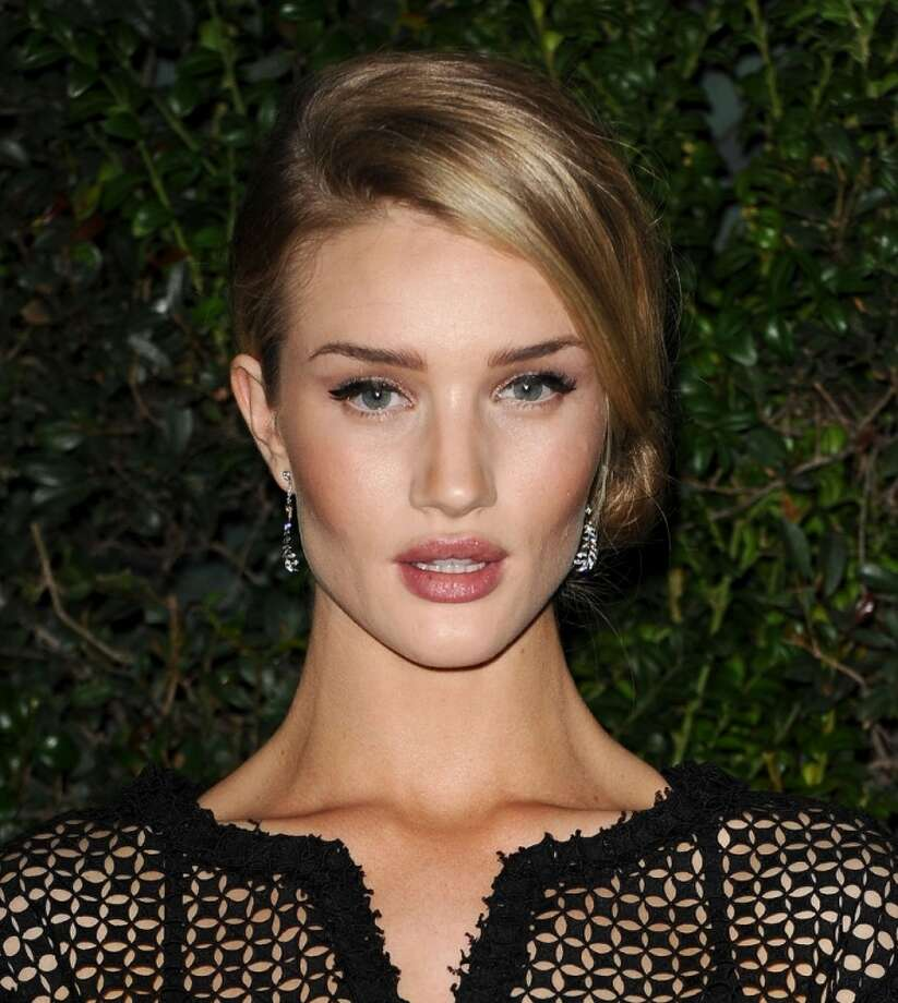 Rosie Huntington-Whiteley has modeled for Victoria's Secret and Burberry, and appeared in 'Transformers: Dark of the Moon,' replacing Megan Fox. Photo: Jason LaVeris, FilmMagic