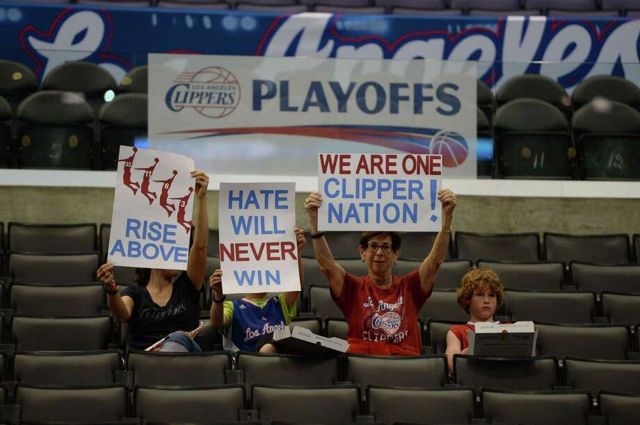 Fans arriving early for Tuesday night's playoff game against the Warriors show their support for the Clippers. Photo: ROBYN BECK, Staff / AFP