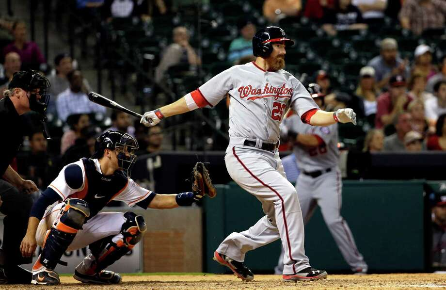 Washington Nationals' Adam LaRoche (25) watches a single that scored Denard Span during the ninth inning of a baseball game, in front of Houston Astros catcher Jason Castro on Tuesday, April 29, 2014, in Houston. (AP Photo/David J. Phillip) Photo: David J. Phillip, Associated Press / AP
