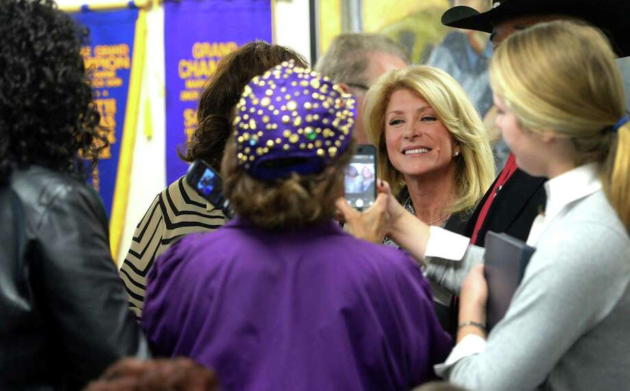 Wendy Davis visits with supporters Friday at the IBEW Hall in Beaumont. Davis spoke touching on issue regarding health and jobs.  Photo taken Friday, March 14, 2014 Guiseppe Barranco/@spotnewsshooter Photo: Guiseppe Barranco, Photo Editor