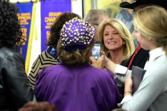 Wendy Davis visits with supporters Friday at the IBEW Hall in Beaumont. Davis spoke touching on issue regarding health and jobs.  Photo taken Friday, March 14, 2014 Guiseppe Barranco/@spotnewsshooter