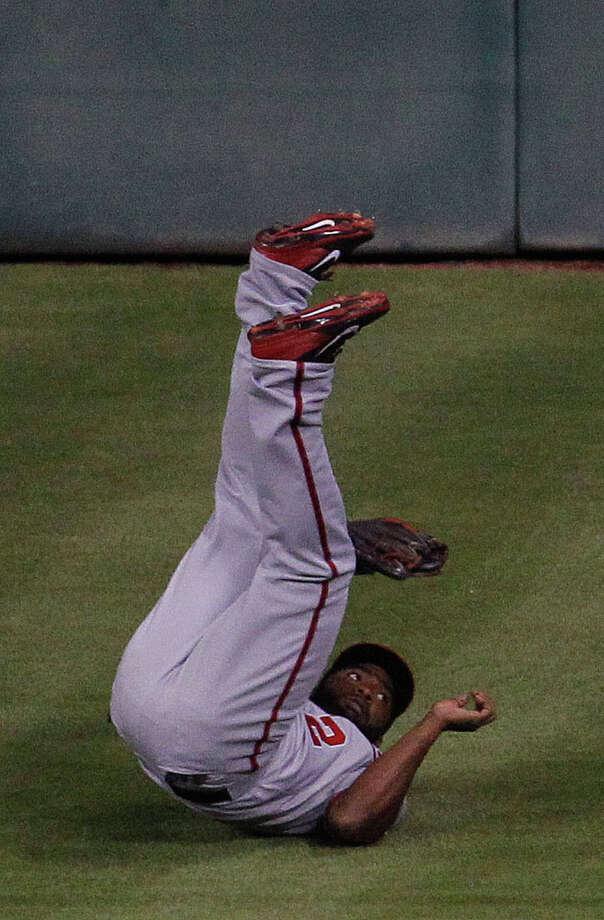 Nationals center fielder Denard Span ventures onto Tal's Hill to rob Matt Dominguez in the fourth inning. Photo: Karen Warren, Staff / © 2014 Houston Chronicle