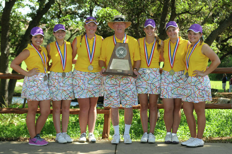 Montgomery's Hannah Rees (sophomore), from left, Ellen Hammond (senior), Kendall Wisenbaker (junior), Coach Rusty Herridge, Reid Isaac (freshman), Riley Isaac (junior) and Kallie Gonzales (senior), show off their 2nd place trophy after the final round of the Class 4A state golf tournament at the University of Texas Golf Club in Austin on Tuesday. Photo: Jerry Baker, For The Chronicle
