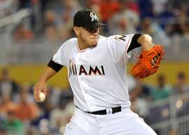 Apr 29, 2014; Miami, FL, USA; Miami Marlins starting pitcher Jose Fernandez (16) throws the ball against the Atlanta Braves during the first inning at Marlins Ballpark. Mandatory Credit: Steve Mitchell-USA TODAY Sports