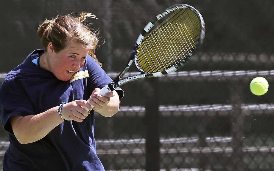 Alamo Heights' Marie Lutz hits a backhand during the Class 4A girls doubles final at UT's Penick-Allison Tennis Center. Photo: Tom Reel / San Antonio Express-News