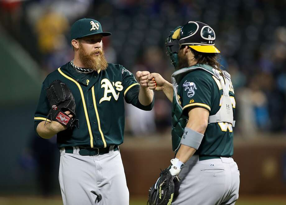Sean Doolittle is congratulated by catcher Derek Norris after finishing the win. Norris had a big night with three RBIs. Photo: Rick Yeatts, Getty Images