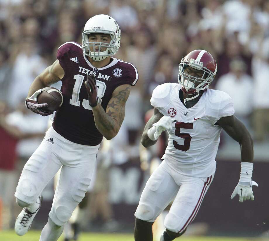Texas A&M wide receiver Mike Evans (left) has been projected by at least two mock drafts to be chosen seventh overall by Tampa Bay. Photo: Karen Warren / Houston Chronicle / © 2013 Houston Chronicle