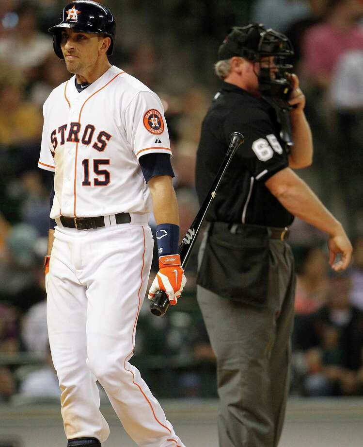 Jason Castro shows his displeasure after striking out in the sixth inning Tuesday night, one of 13 strikeouts by the Astros. Photo: Karen Warren, Staff / © 2014 Houston Chronicle