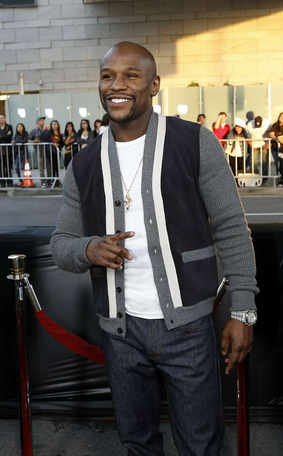 "Professional boxer Floyd Mayweather Jr. poses at the premiere of ""A Haunted House 2"" in Los Angeles, California April 16, 2014. The movie opens in the U.S. on April 18.   REUTERS/Mario Anzuoni  (UNITED STATES - Tags: ENTERTAINMENT SPORT BOXING) Photo: Mario Anzuoni, Reuters"