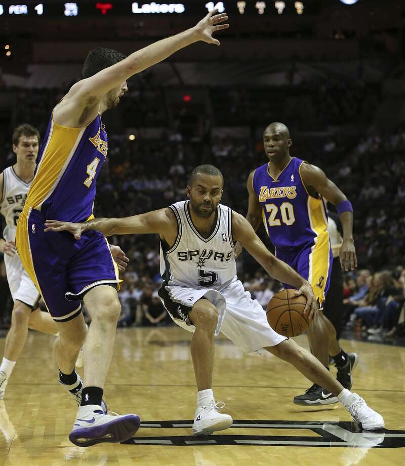 San Antonio Spurs' Tony Parker keeps Los Angeles Lakers' Ryan Kelly away from the ball during the first half at the AT&T Center, Wednesday, April 16, 2014. Photo: Jerry Lara, San Antonio Express-News