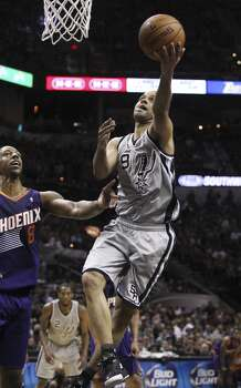 Spurs' Tony Parker (09) lays up a shot against Phoenix Suns' Channing Frye (08) in the first half at the AT&T Center on Friday, Apr. 11, 2014. Photo: Kin Man Hui, San Antonio Express-News