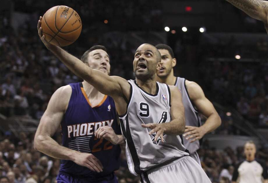 Spurs' Tony Parker (09) drives into the lane against Phoenix Suns' Miles Plumlee (22) in the second half at the AT&T Center on Friday, Apr. 11, 2014. Spurs defeated the Suns, 112-104, and clinches home court advantage throughout the playoffs. Photo: Kin Man Hui, San Antonio Express-News