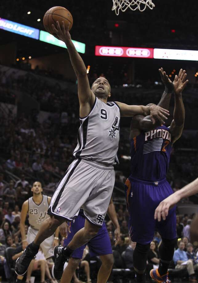 Spurs' Tony Parker (09) lays up a shot against Phoenix Suns' Eric Bledsoe (02) in the second half at the AT&T Center on Friday, Apr. 11, 2014. Spurs defeated the Suns, 112-104, and clinches home court advantage throughout the playoffs. Photo: Kin Man Hui, San Antonio Express-News