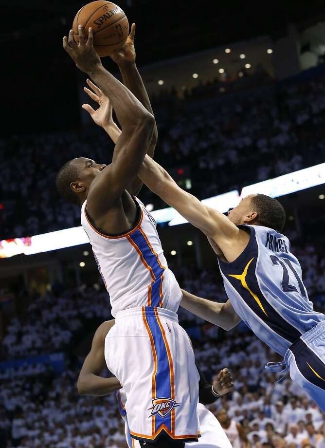 Thunder forward Serge Ibaka's final shot, defended by Tayshaun Prince, went in, but was ruled too late to count. Photo: Associated Press