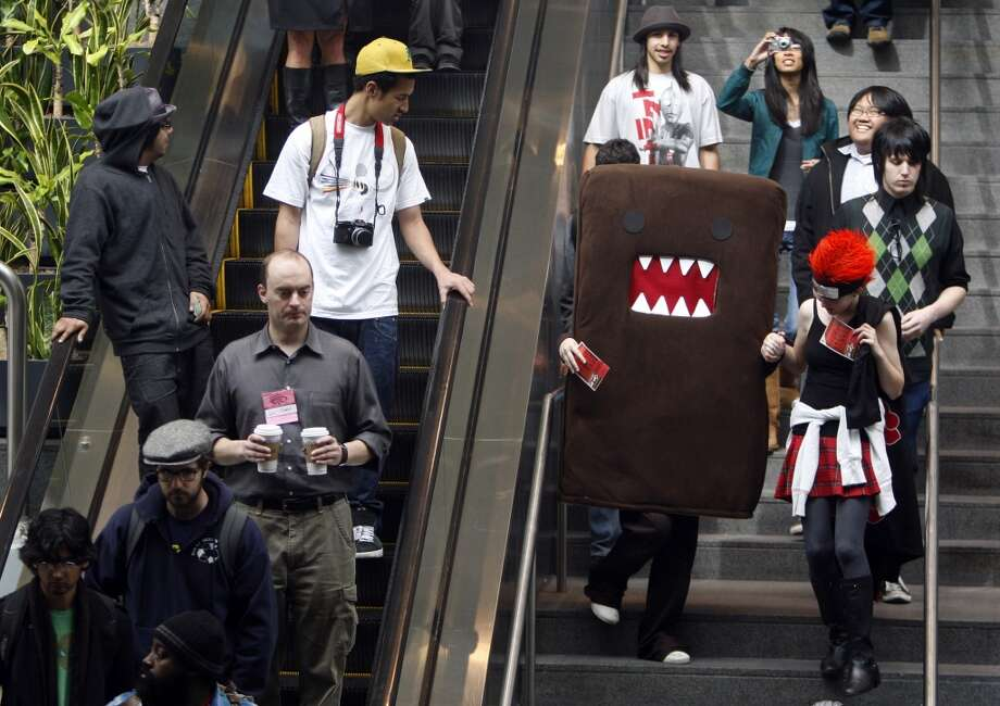 WonderCon at the Moscone Center in 2009. Giant costumed characters riding elevators are always a good photo opportunity. Photo: Paul Chinn, The Chronicle