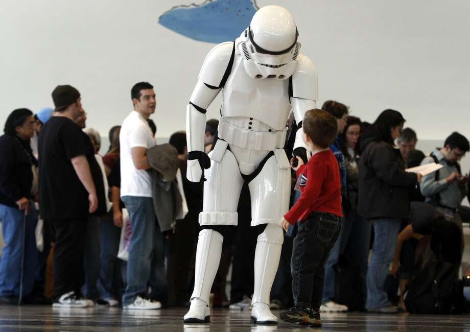 An Imperial stormtrooper greets three-year-old Charlie Goff from Sacramento at the WonderCon  convention in 2009. Photo: Paul Chinn, The Chronicle