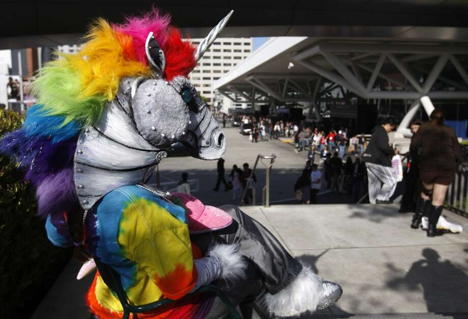 A unicorn who identified herself as Beast Cub takes a break outside WonderCon in 2010. Photo: Paul Chinn, The Chronicle