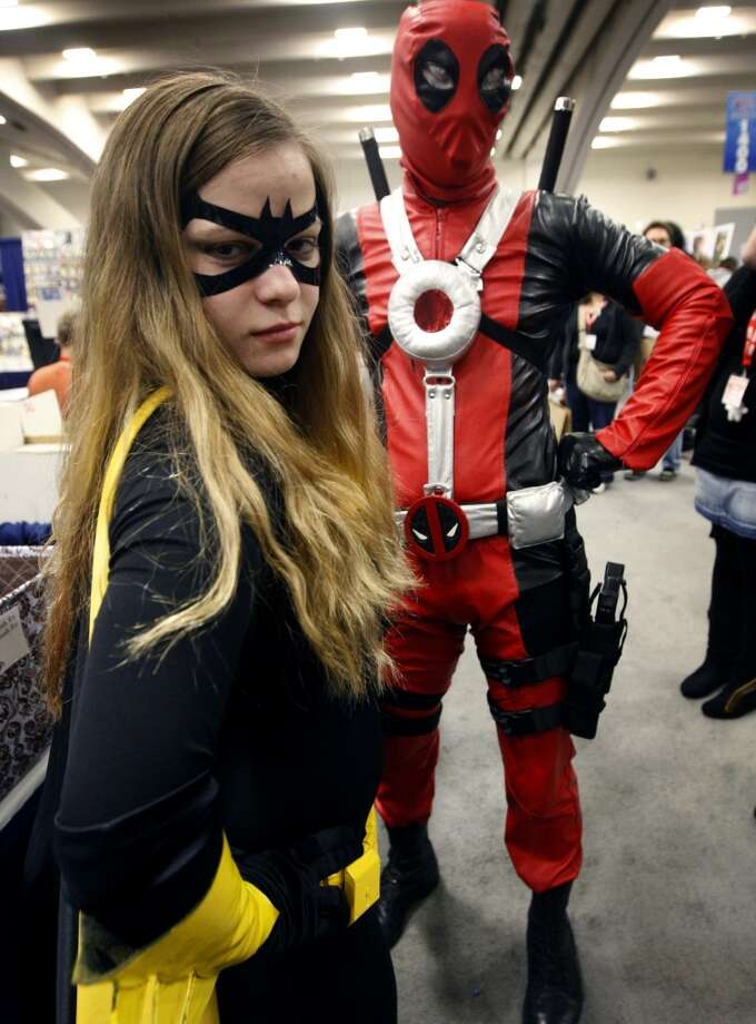 Batgirl and Deadpool, aka Svetlana Chyette (left) and Clyde Max, are ready to protect and serve at the 2009 WonderCon comic book convention.. Photo: Paul Chinn, The Chronicle