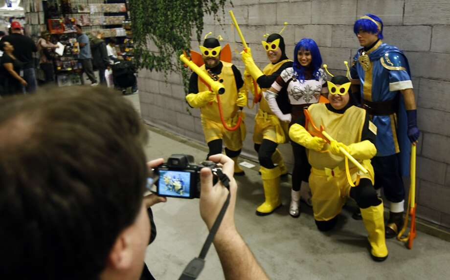 The Monarch Henchmen pose for photographs with other costumed characters at WonderCon in 2009. Photo: Paul Chinn, The Chronicle