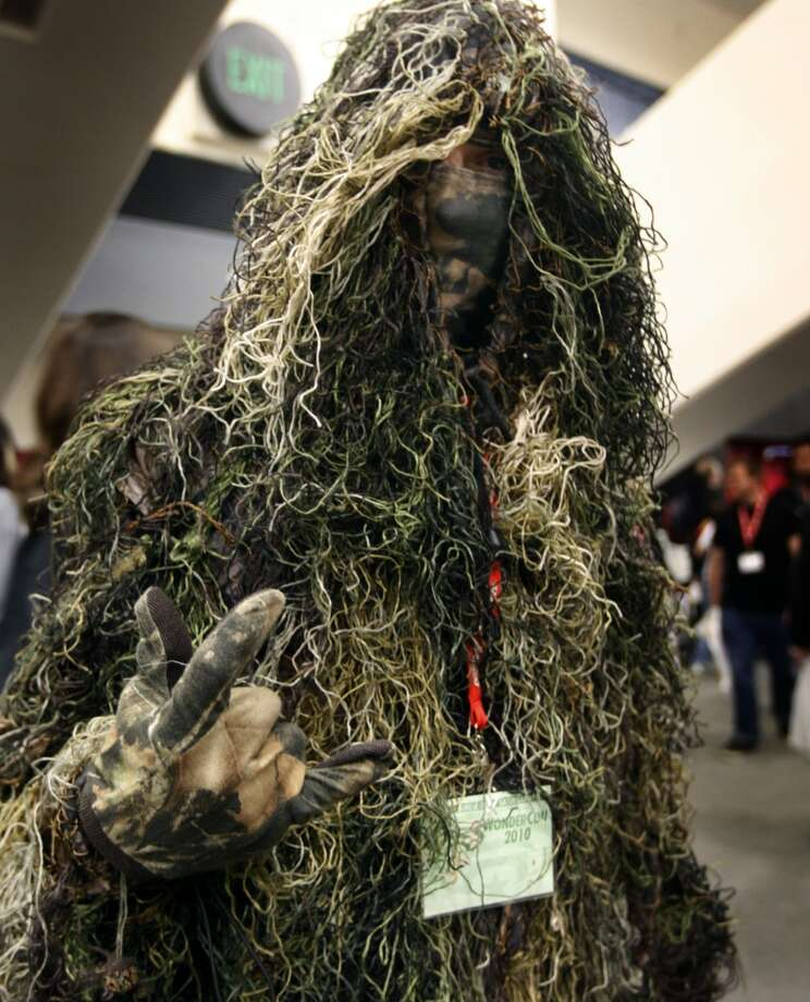 Swamp Thing or a military man in deep camouflage? In either case, Connor Goodwin entertains fans at WonderCon in 2009. Photo: Paul Chinn, The Chronicle