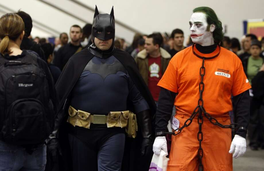 Batman and the Joker, brothers Edward (left) and Jim Delaney in real life, enjoy the 2009 WonderCon. Photo: Paul Chinn, The Chronicle