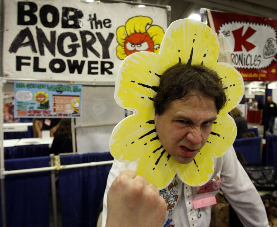 Comic artist Stephen Notley set up shop as his Bob the Angry Flower character at WonderCon in 2009. Photo: Paul Chinn, The Chronicle