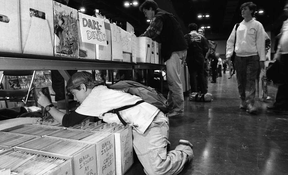 The early years: A young comics fan looks for something good at the Wonderful World of Comics expo in 1988, which would later become WonderCon. Photo: Scott Sommerdorf, The Chronicle
