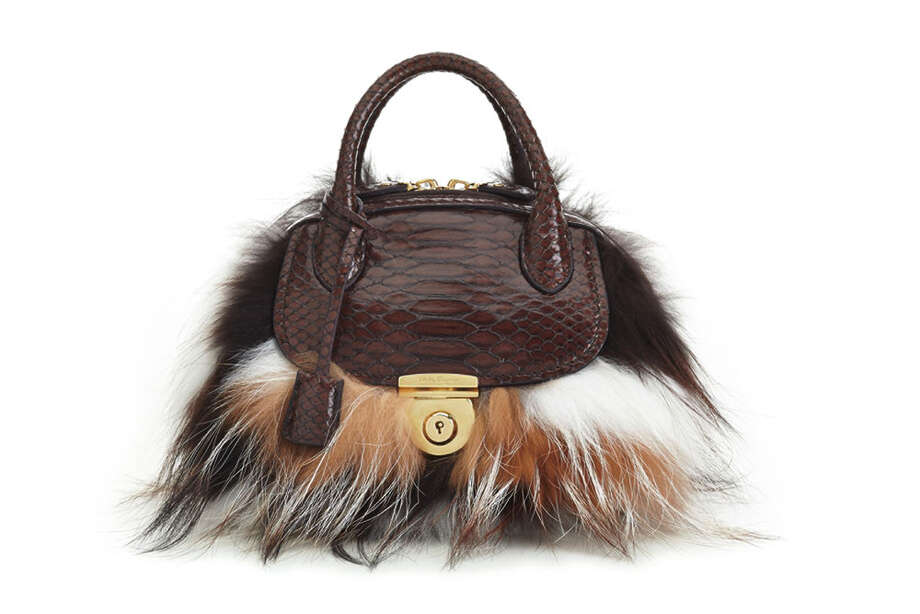 The new Fiamma purse, which Ferragamo hopes will become a new iconic handbag, comes in three sizes, and a variety of materials including fur (shown),calfskin, sting ray, pony and Swarovski crystals. Prices range from $1,650 to more than $4,200. Photo: All Photos Courtesy Of Ferragamo