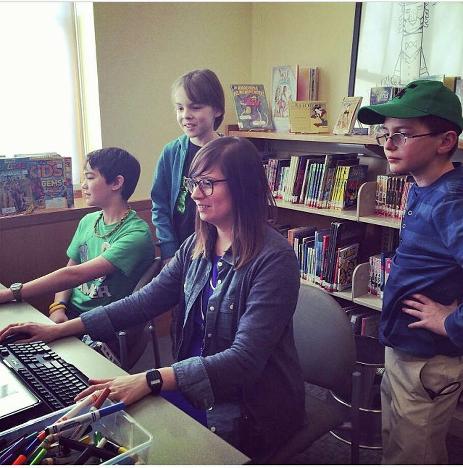 Minecraft Fridays continue at the Darien Library, where users like Kiran Daly, Sage Gray, Amy Laughlin and Graham Sesselberg play, build and collaborate. Photo: Contributed Photo, Contributed / Darien News