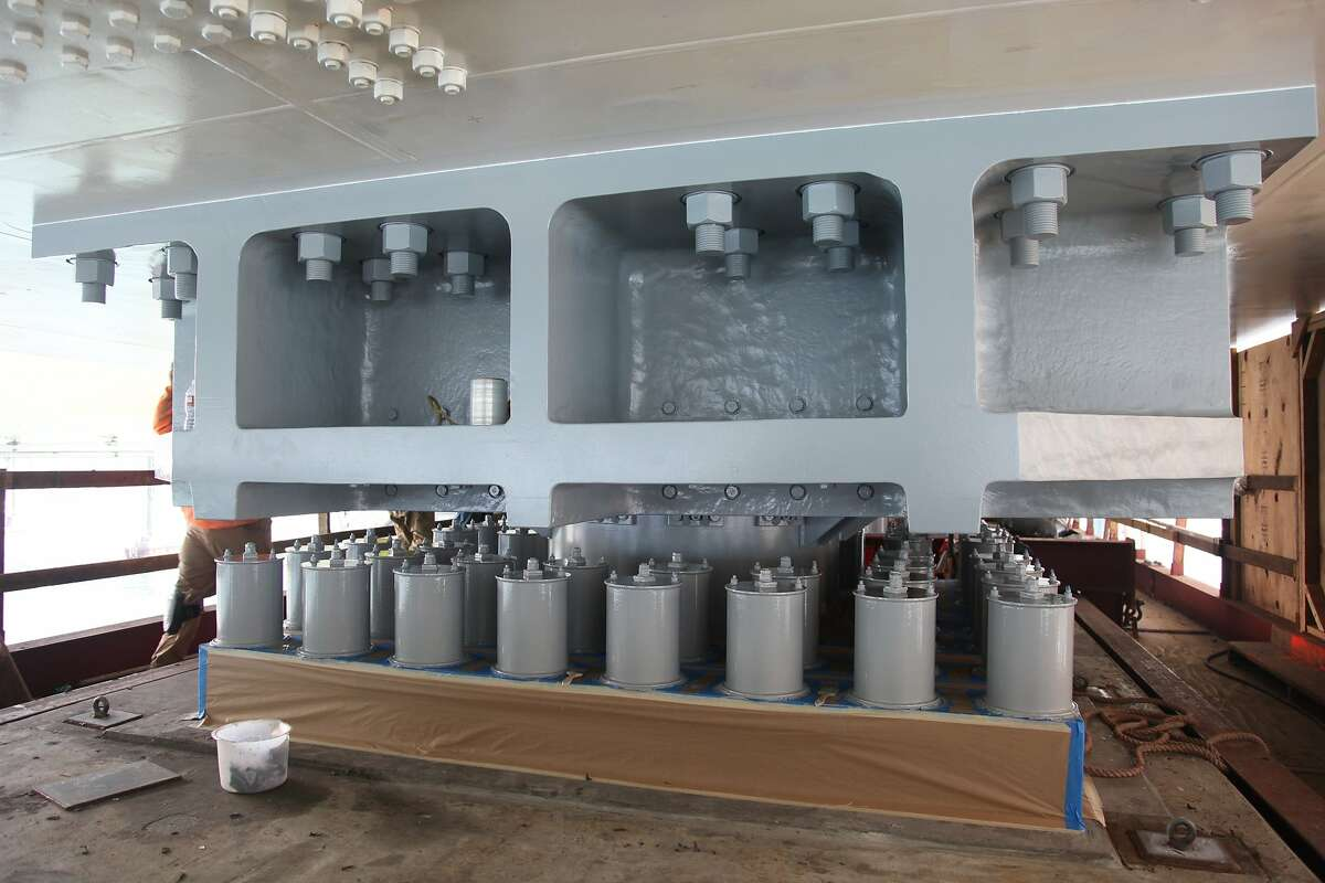 Cylindrical objects known as grease caps on the new Bay Bridge eastern span. The grease-filled containers protect galvanized-steel rods from being invaded by hydrogen, which can cause them to crack prematurely.