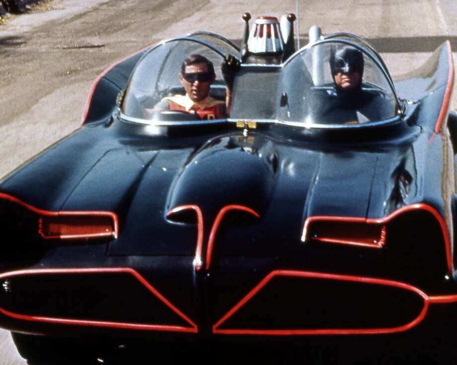 Burt Ward, US actor, and Adam West, US actor, both in costume as the 'Dynamic Duo' riding in the Batmobile in a publicity still issued for the television series, 'Batman', USA, circa 1966. The television series featuring DC Comics characters, starred West as 'Batman', and Ward as 'Robin'. Photo: Silver Screen Collection, Getty Images / Moviepix