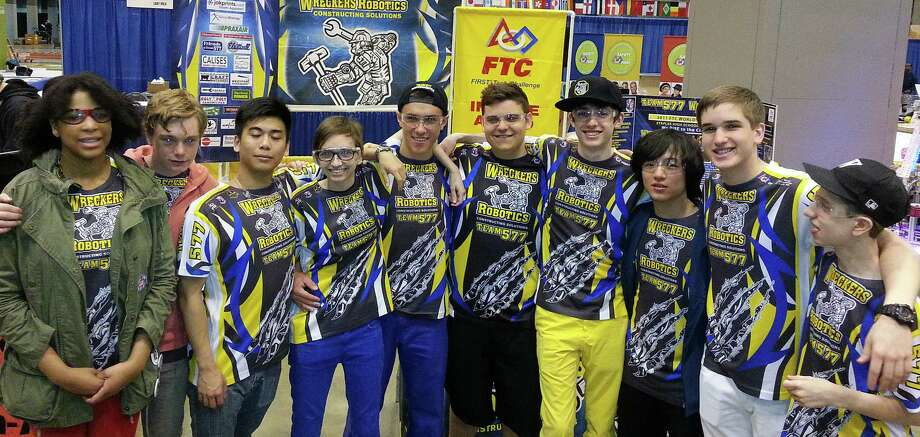 Members of the Wreckers Robotics team traveled to the recent FIRST Robotics World Championships in St. Louis. Photo: Contributed Photo / Westport News