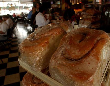 Three-pound cinnamon rolls await diners at Lulu's Bakery and Café. Photo: LISA KRANTZ, SAN ANTONIO EXPRESS-NEWS / SAN ANTONIO EXPRESS-NEWS