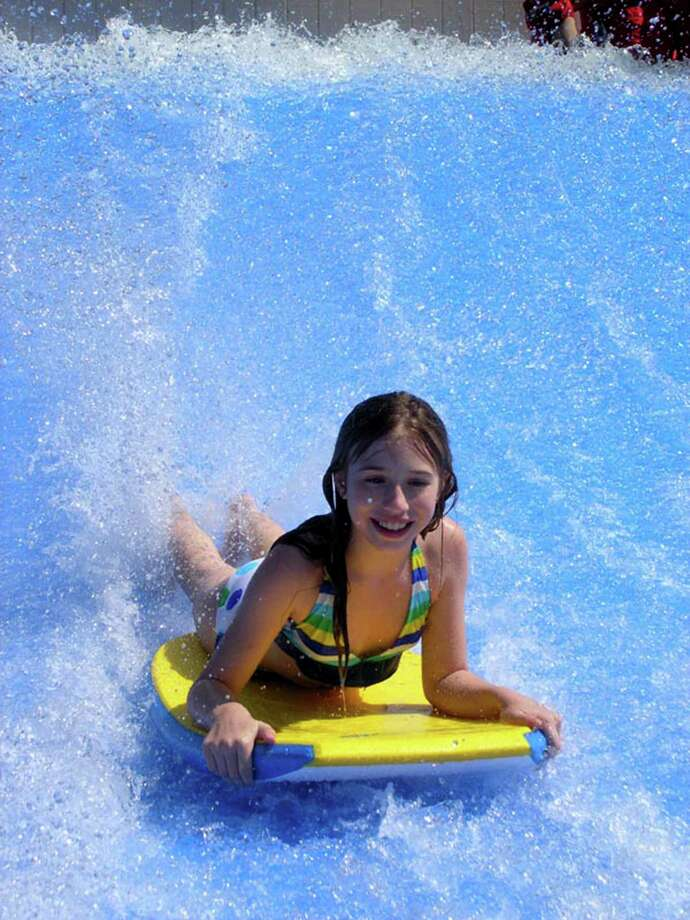 Wet 'n' Wild SplashTown will be open 10 a.m.-5 p.m. Fridays and 10 a.m.-6 p.m. Saturdays and Sundays through May 18. The park will begin daily operation on May 22. The park will debut three new attractions this season. The FlowRider challenges guest to body board on wavess moving at 35 miles per hour. Photo: Courtesy Photo / ONLINE_YES