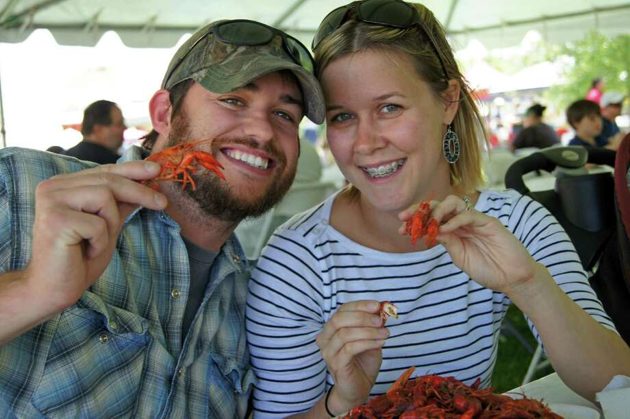 Mike and Amber Davis of Pinehurst enjoy some crawfish at the 2013 Rails & Tails Mudbug Festival in Tomball. Photo: Courtesy Photo / ONLINE_YES