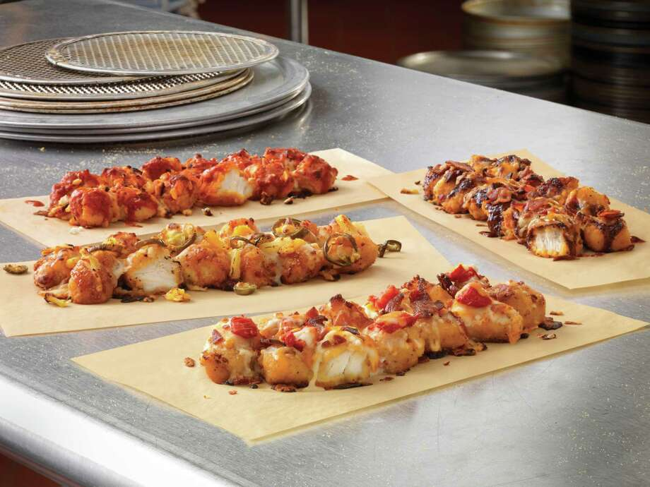 Domino's has created four styles of Specialty Chicken. Photo: Jeff Padrick - Klug Studio Inc. / Klug Studio Inc.