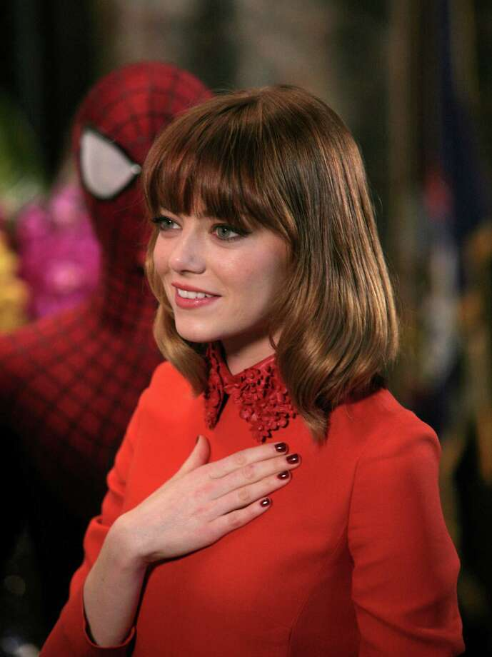 """Actress Emma Stone attends a lighting ceremony at the Empire State Building with the cast of """"The Amazing Spider-Man 2"""" on Friday, April 25, 2014, in New York. (Photo by Andy Kropa/Invision/AP) Photo: Andy Kropa, INVL / Invision"""