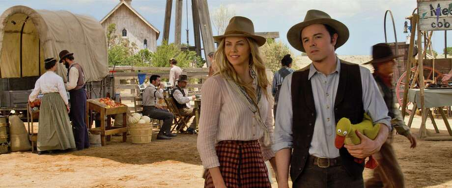 """Seth MacFarlane and Charlize Theron star in """"A Million Ways to Die in the West."""" Photo: Universal Pictures / San Antonio Express-News"""