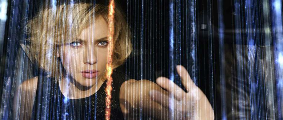 "Scarlett Johansson stars in ""Lucy."" Photo: Universal Pictures / San Antonio Express-News"